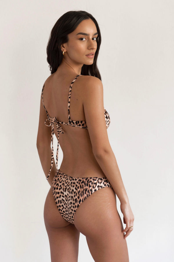 BIKINI DOLLS Arielle ruched bikini bottom in Just Leopard animal print