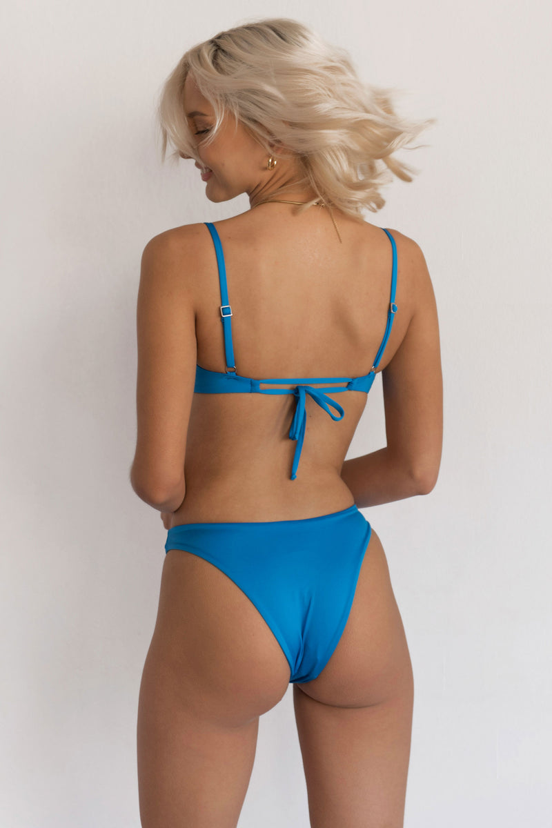BIKINI DOLLS Naomi high-cut bikini bottom in Azure Blue