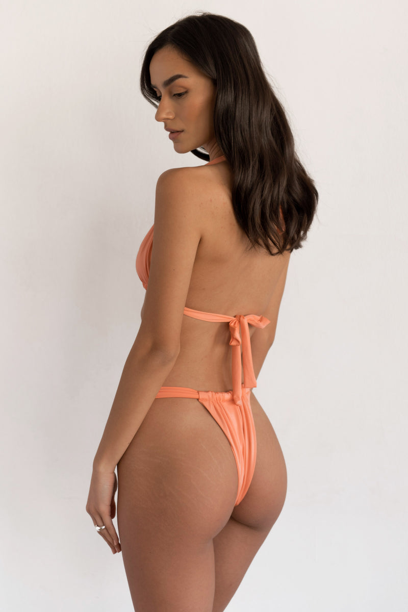 BIKINI DOLLS Cindy ruched high-cut bikini bottom in Peach Pink