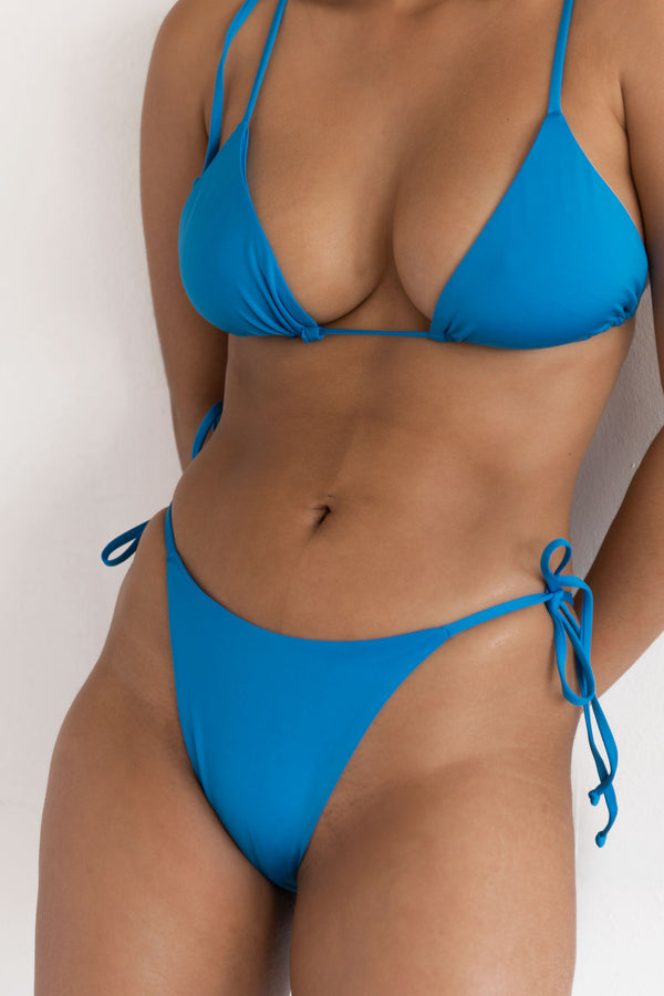 BIKINI DOLLS Gia side tie high-cut bikini bottom in Azure Blue