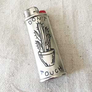 Brooke Powell x Hyena Mfg. Don't Touch Engraved Lighter Sleeve