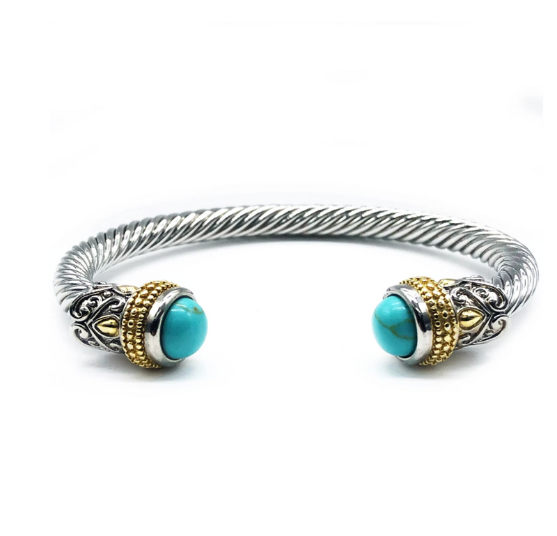 This silver cable cuff bracelet with gold detail and turquoise caps