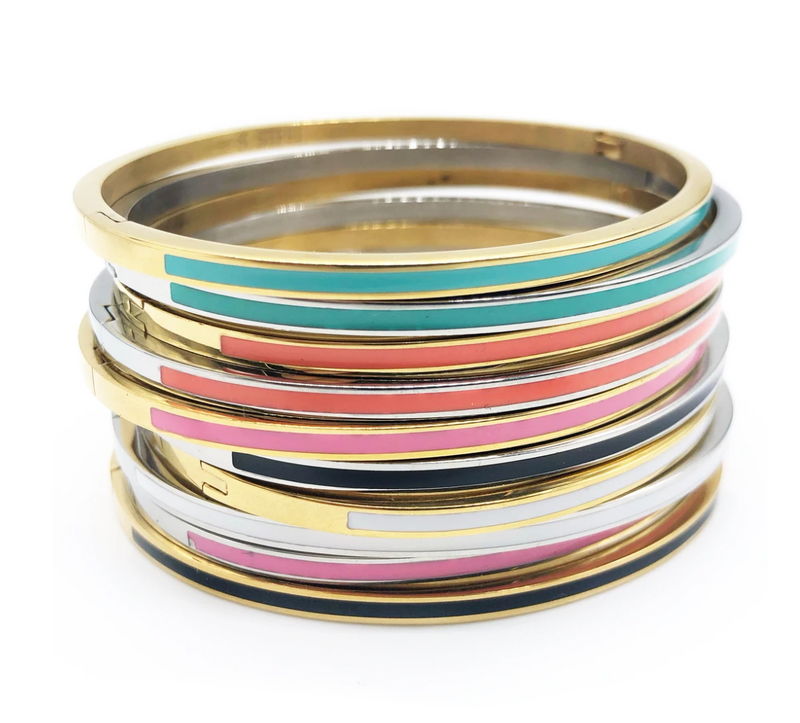 Many gold and silver bracelets with colorful enamel