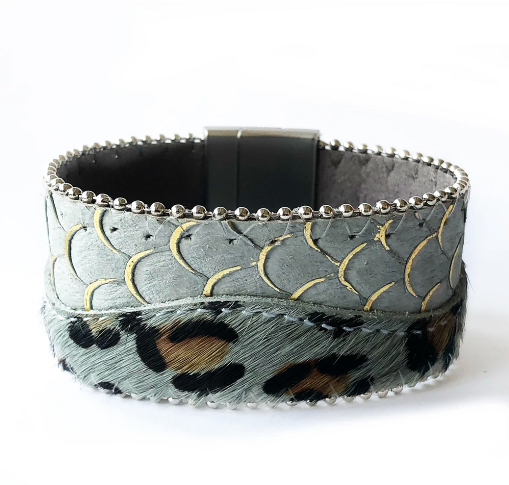 Magnetic clasp bracelet with leopard print and scale design in a sage green background