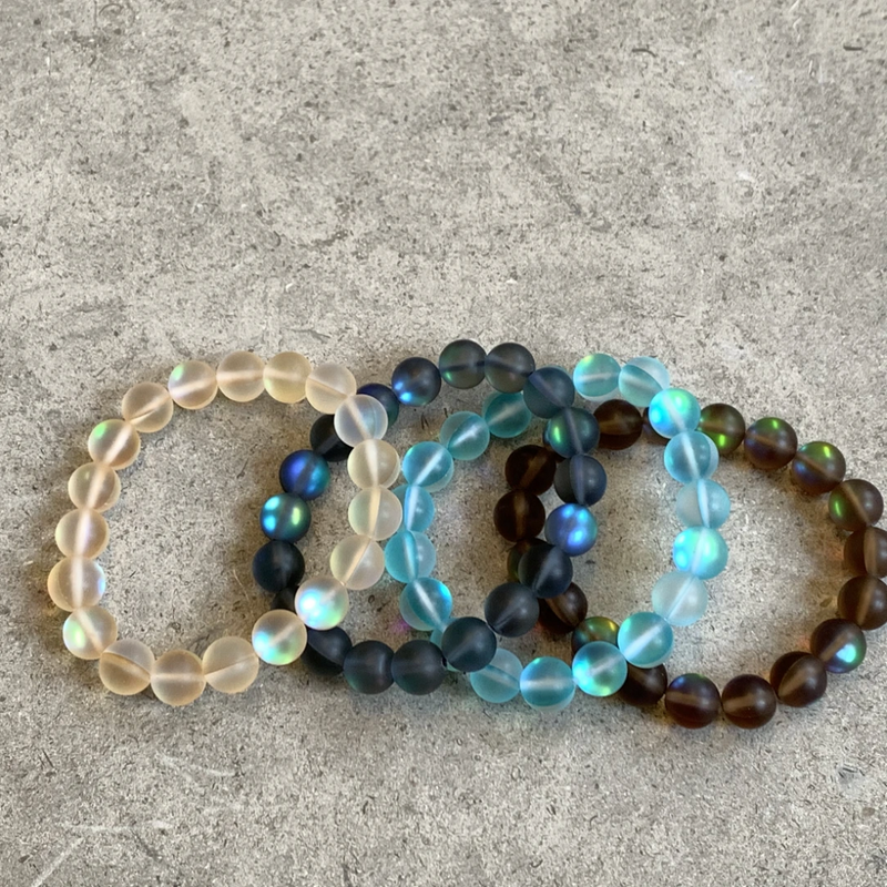 Four Bracelets made of iridescent beads