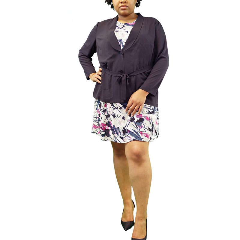 White plus size dress with blue and fuchsia pattern with a navy blazer