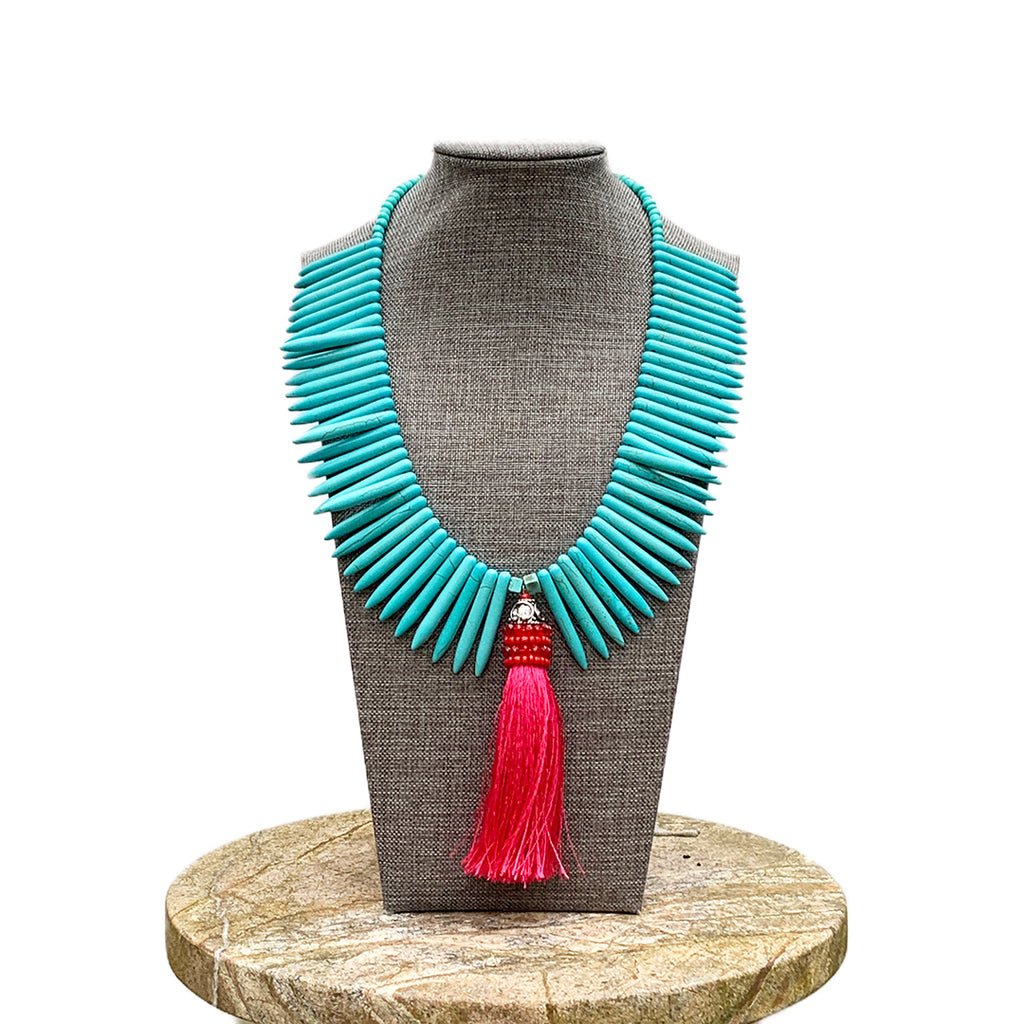 Turquoise bead necklace with bright pink tassel