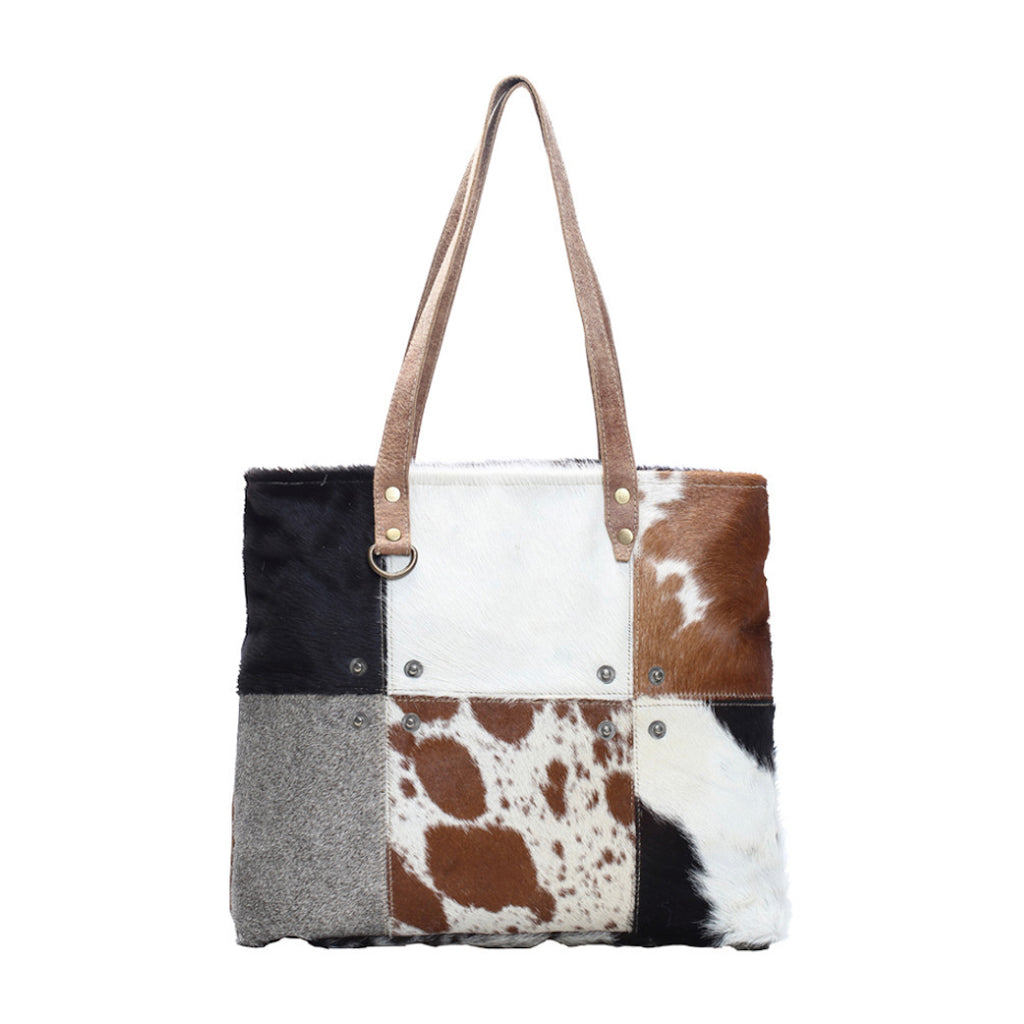 Hair on leather tote bag with 6 different panels of different leather
