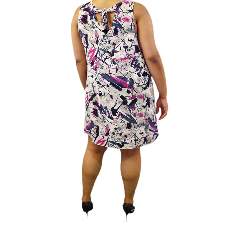 White plus size dress with blue and fuchsia pattern