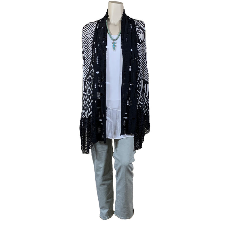 Black and white duster vest with mesh edging, white top, green NYDJ jeans