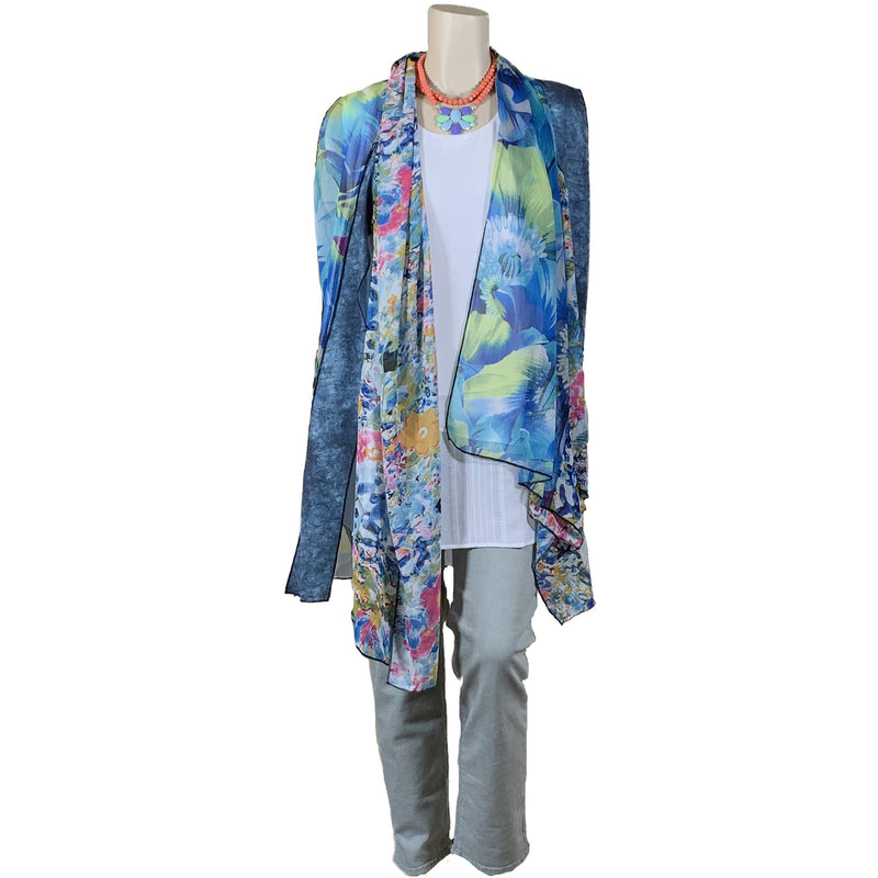 Layered white plus size tank top with blue floral duster and green jeans