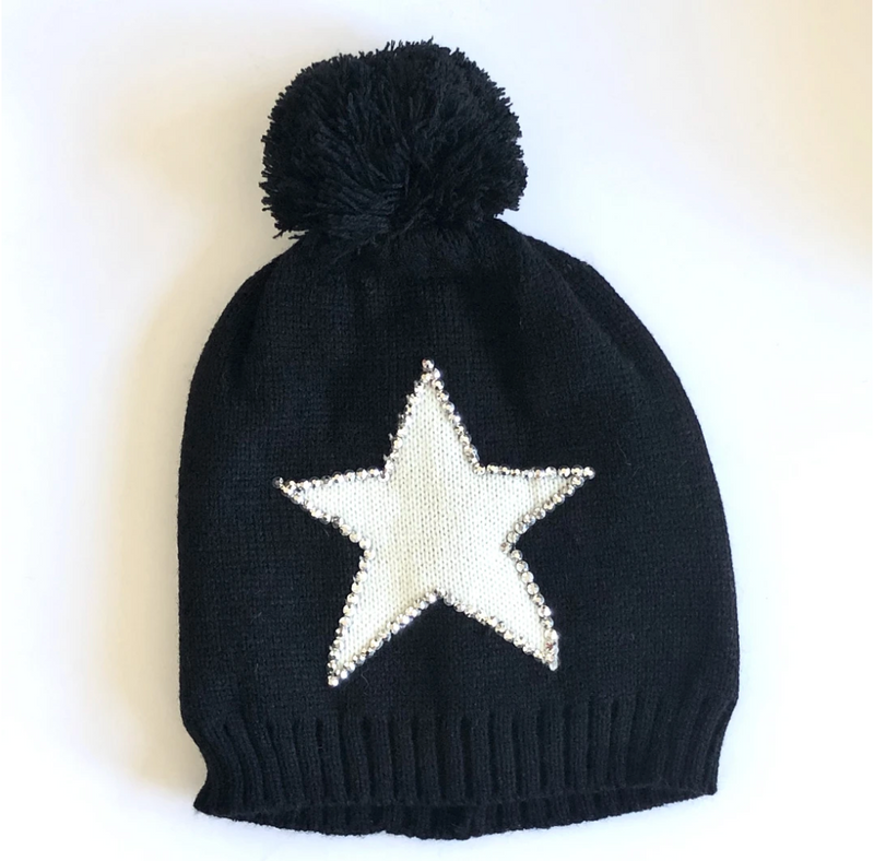 Black winter hat with pom pom and white star with sequin edging