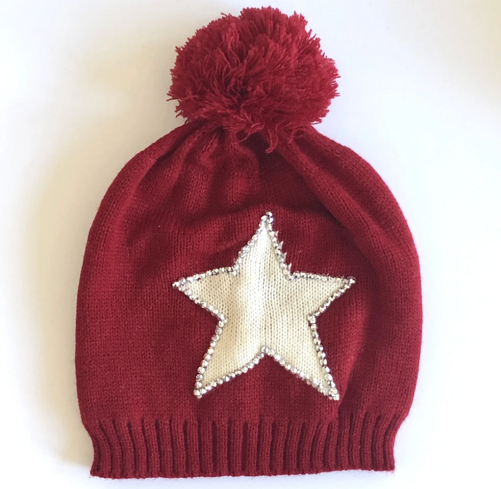 Red winter hat with pom pom and white star with sequin edging