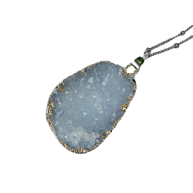 Light grey geode in a silver setting on a delicate silver beaded chain