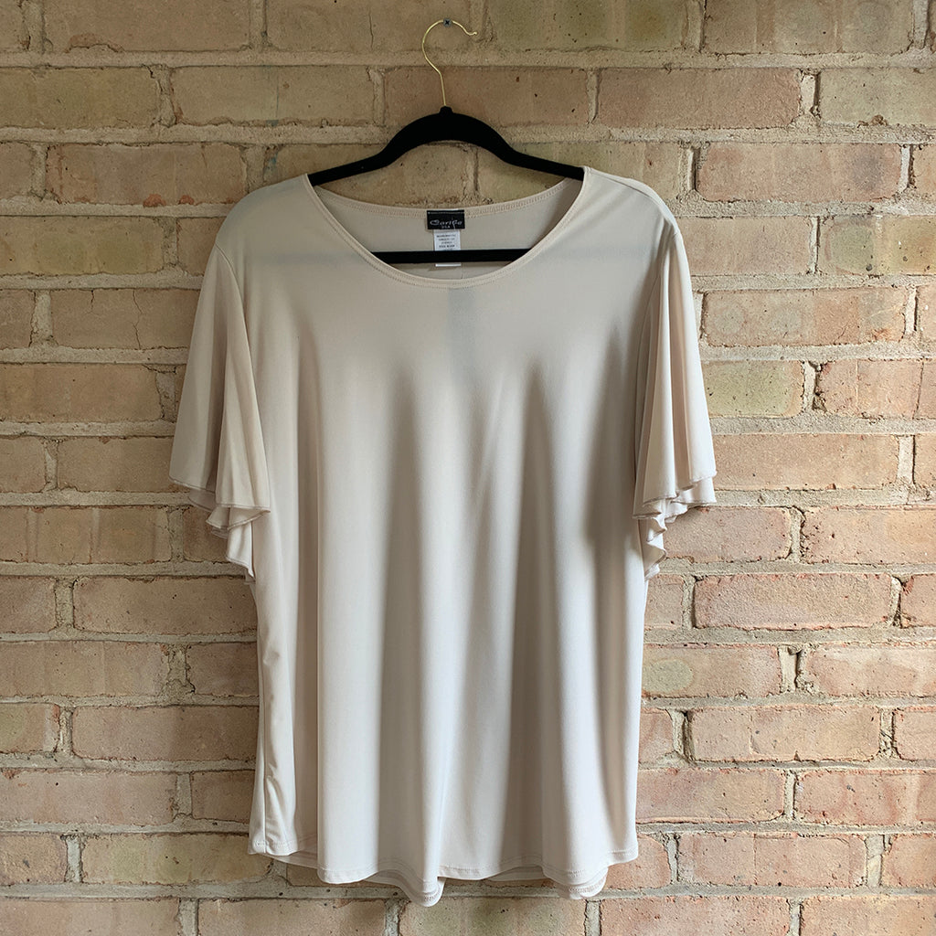 Plus size short sleeved cream colored blouse