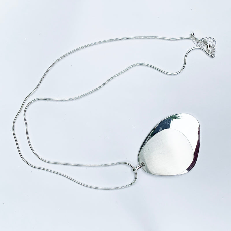 Silver necklace with matte and glossy silver pendants