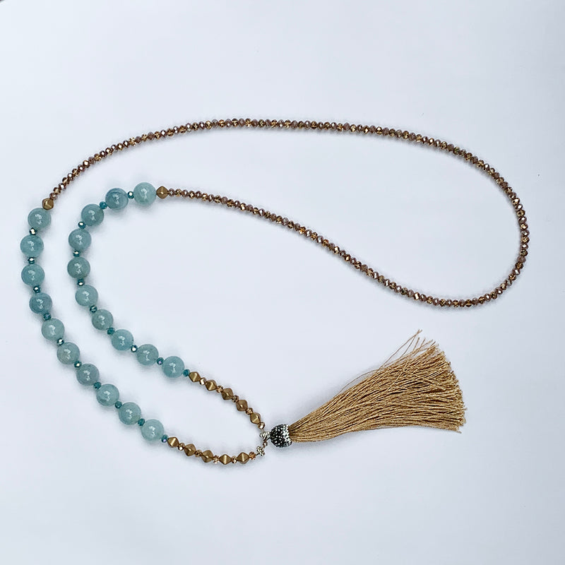 Stunning long necklace with crystal, marble, and gold beads, gold tassel