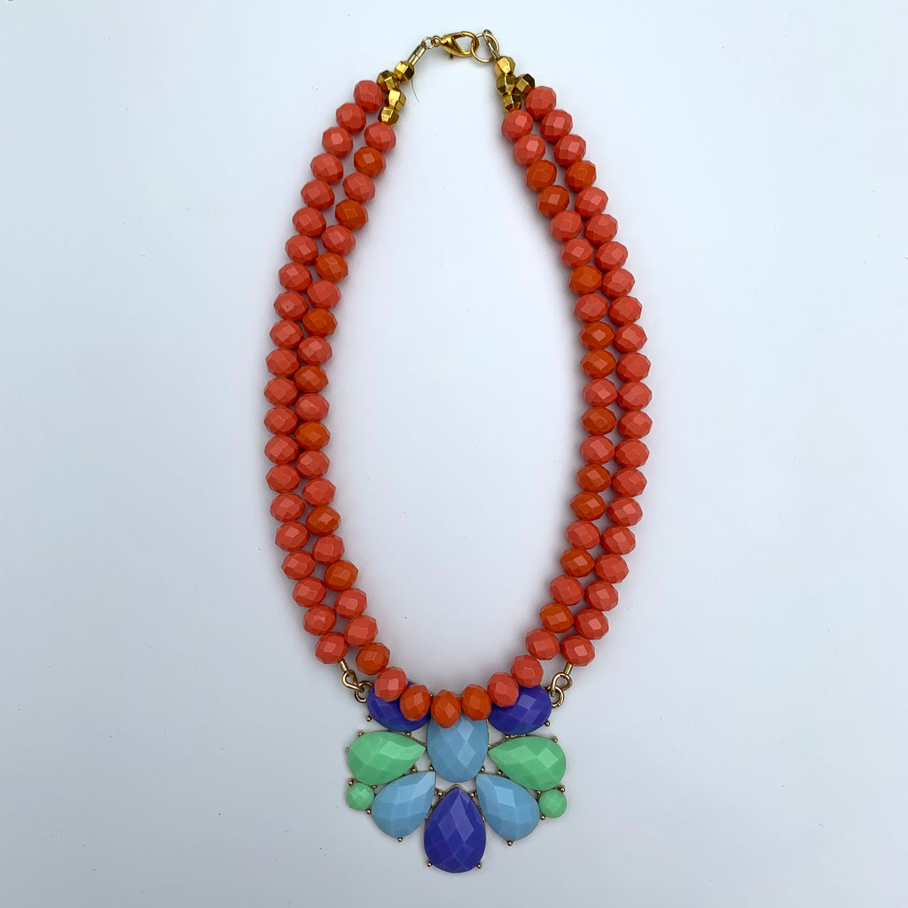 Necklace with double strand of coral beads, pastel floral pendant