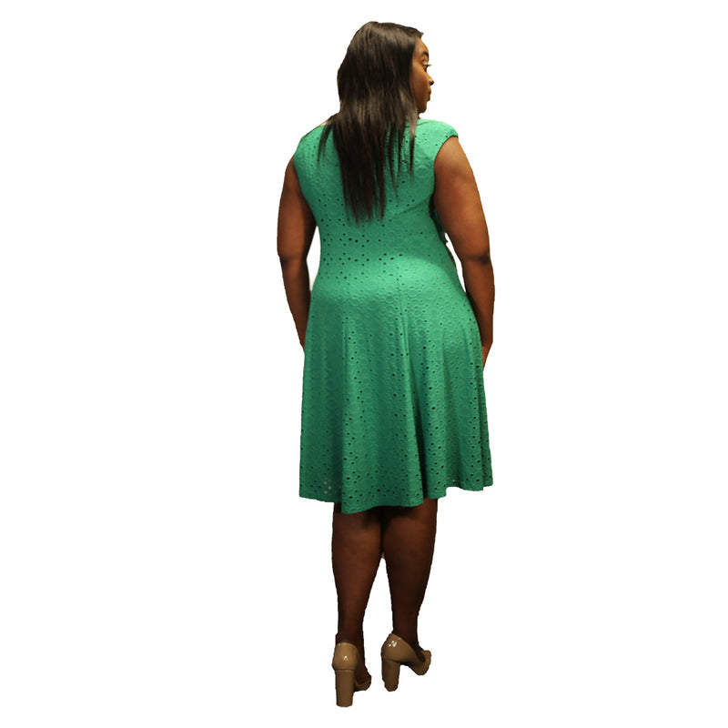 Green knee-length dress with eyelet pattern