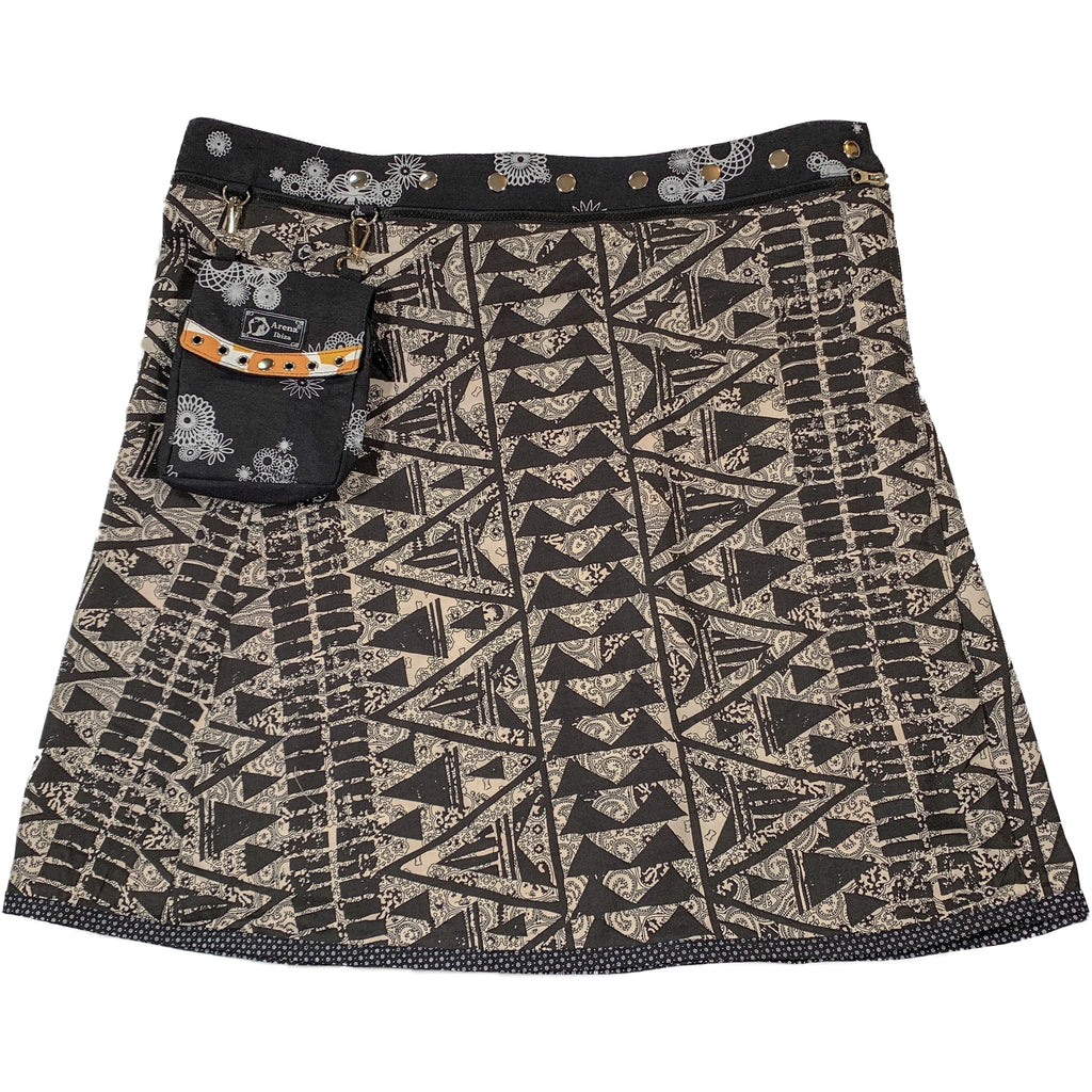 Multi-colored wrap miniskirt in a black and white geometric print.  The waistband is a black and white print.  Snaps run the length of the waistband.  A small purse, which matches the waistband, is attached to the waistband.