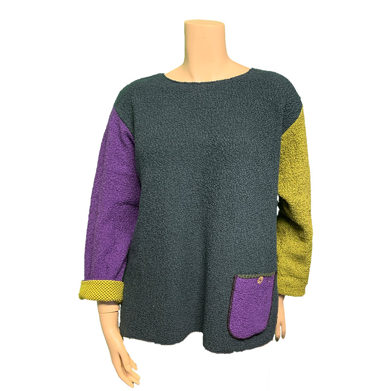 Purple, teal, and chartreuse color-blocked designer plus size sweater