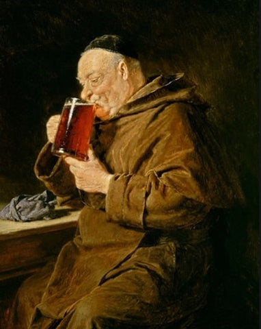 Monk drinking beer in a monastery
