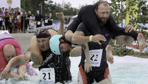 man carrying wife in the wife carrying championship in Finland