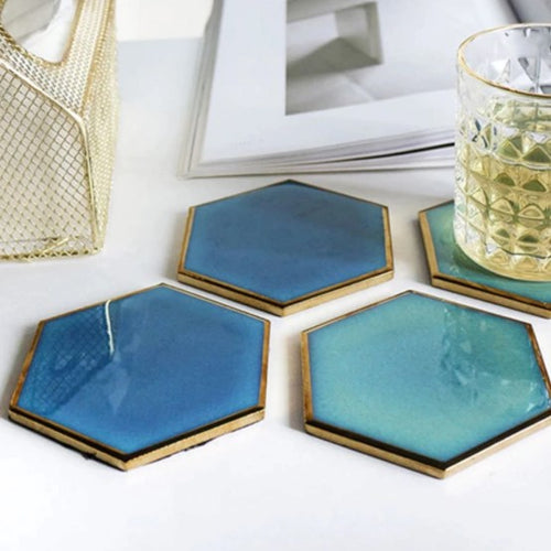 ceramic coasters on a table