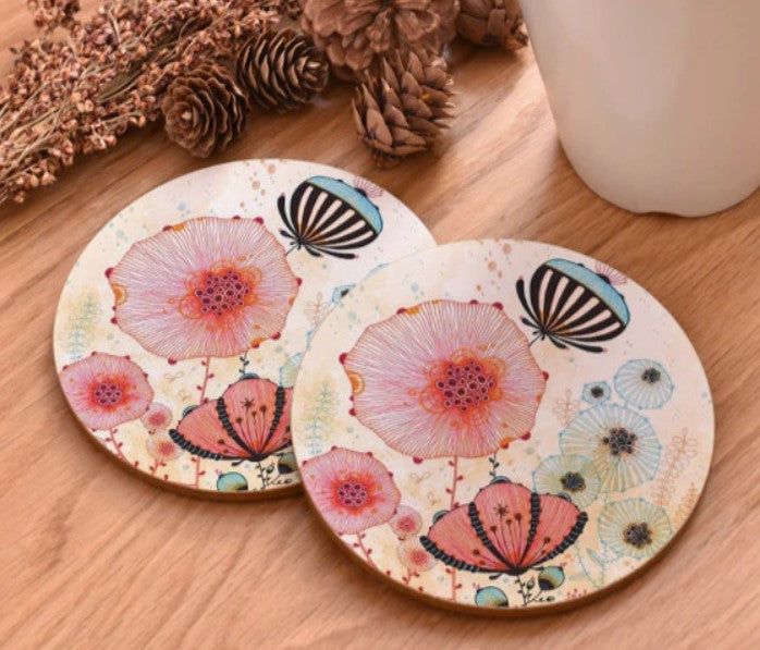 cork coasters on a table - flowery design 10