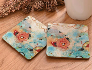 cork coasters on a table - flowery design 11