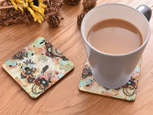 cork coasters on a table - flowery design 13