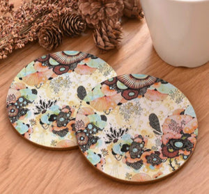 cork coasters on a table - flowery design 14