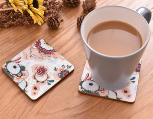 cork coasters on a table - flowery design 17