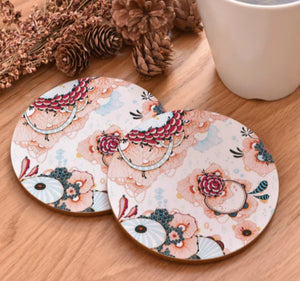 cork coasters on a table - flowery design 18