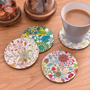 cork coasters on a table - flowery design 2