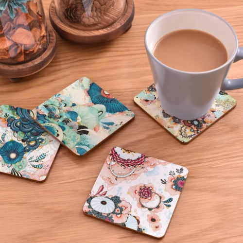 cork coasters on a table - flowery design 1