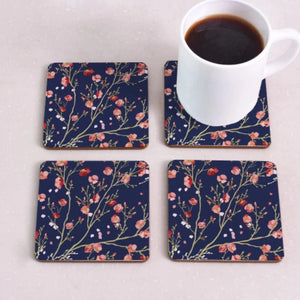 cork coasters on a table - flowery design 5