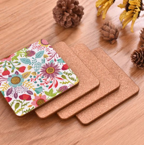 cork coasters on a table - flowery design 6