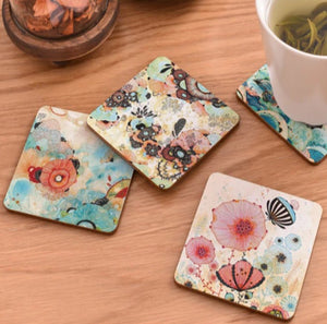 cork coasters on a table - flowery design 7