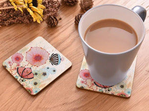 cork coasters on a table - flowery design 9