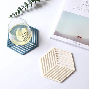 hexagon coasters on a table 5