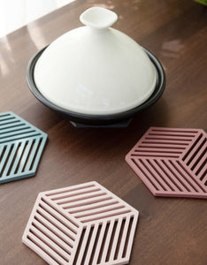 hexagon coasters on a table 9