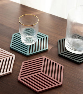 hexagon coasters on a table
