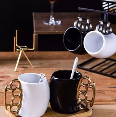 Black or white mug with golden or silver metal knuckle
