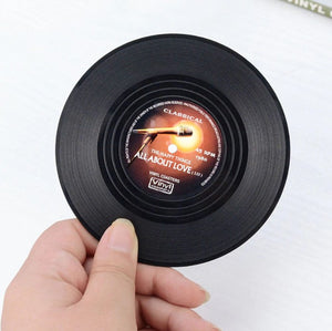 vinyl record coasters on a table 10