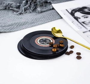 vinyl record coasters on a table 11