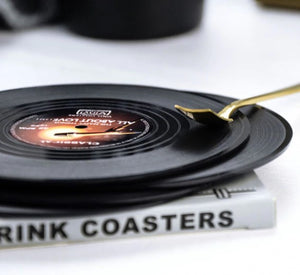 vinyl record coasters on a table 4