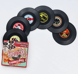 vinyl record coasters on a table 8