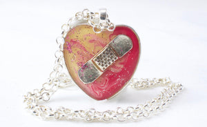 Pink and Yellow Bandaid Necklace - Jenny Bagwill Art