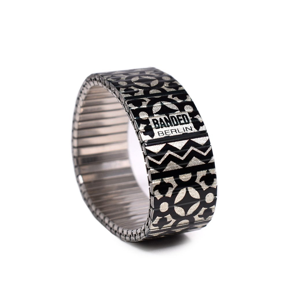 From the Banded Berlin Fertile Crescent collection, This Black and cream Arabic tile inspired design conjures up fond memories of our nights in Marrakesh and beyond. Made from the iconic stainless steel expandable watch band. Scratch resistant and watch proof. Made in Berlin, Germany by Banded Berlin Bracelets